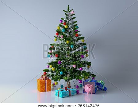 Decorated With Multicolored Balls And Toys Pigs Christmas Tree With Gifts And Piggy Bank On The Grey