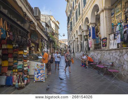 Greece, Corfu, Kerkyra Town, September 26, 2018: Corfu Old Town Main Street Walking Tourist And Peop