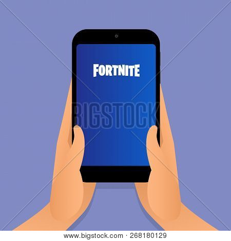 Elva, Estonia - November 11, 2018: Person Is Holding A Smart Phone With Fortnite Video Game Logo On