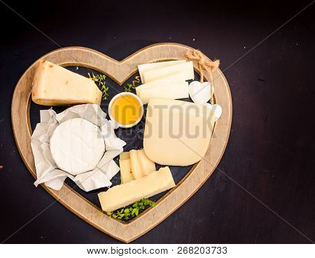 Various Types Of Cheese On Rustic Wooden Table, Goat Cheese, Chevre, Grana Padana