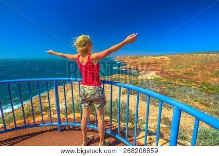 Happy Backpacker Woman At Eagle Gorge Lookout Platform In Kalbarri National Park, Western Australia.