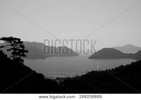 Landscape With The Mountains And The Sea. Seascape Background. Black And White