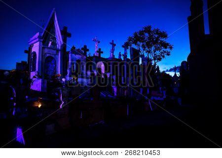 Merida, Cementerio General, Mexico - 31 October 2018: Dark Blue And Pink Lightened Tombstones During