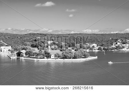 Naval storehouse and careening wharf in Mahon, Spain. Boats in sea harbor. Sea coast on sunny blue sky. Summer vacation on mediterranean island. Travelling and wanderlust. poster