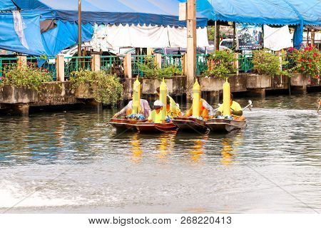 Samutsakorn, Thailand - July 27, Four Boat Parade People In Boat Traditional Of Candles To Temple At