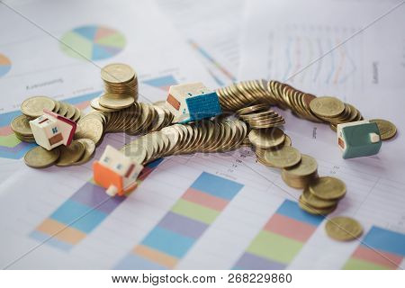 House Model And  Coin Money, Concept Of Property Management. Invesment And Risk Management. Failure.