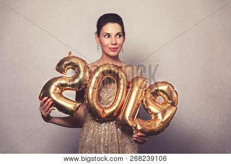 Happy New Year. Beautiful Woman With Balloons Celebrating New Years Eve Party. Smiling Girl In Brigh