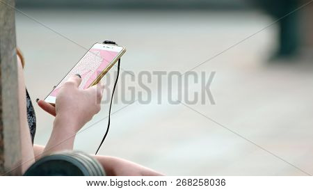 Woman Buying Purchase Via Smartphone. Woman Buying Clothing With Mobile Phone App. E-shopping And E-