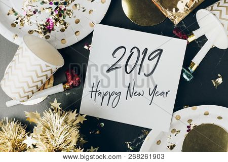Happy New Year 2019 Hand Brush Stroke Font In White Greeting Card On Marble Table With Party Cup,par
