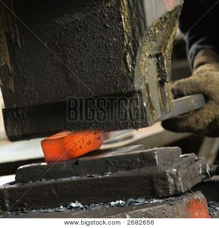Man Using Power Hammer.
