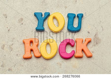 You Rock Compliment In Colorful Letters. Object. Close Up. Macro Photography