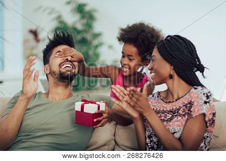 Happy Black Family At Home. African American Father, Mother And Child Celebrating Birthday, Having F