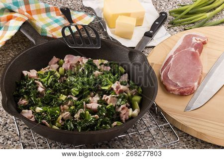 Preparing A Very Irish Dish Colcannon With Kale And Bacon In A Pan