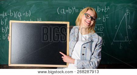 Hometask Information. Teacher Show School Information. Teacher Smart Smiling Woman Hold Blackboard B