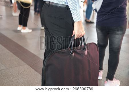 Stylish Man Is Standing And Holding Black Handbag While Going At Job In Public Transport. Profession