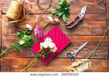 The Workplace Of The Florist To Work. Top View. Making Floral Decorations. Flowers On A Old Wooden T