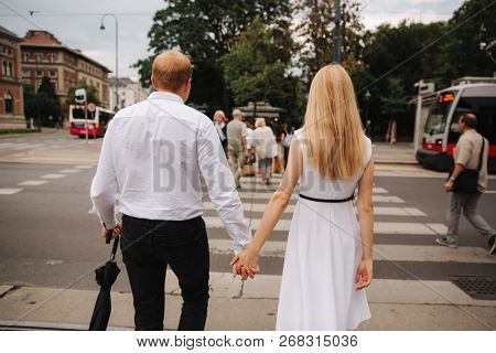 Back View Of Couple. They Are Walking In The Cente Of Austia, Viena