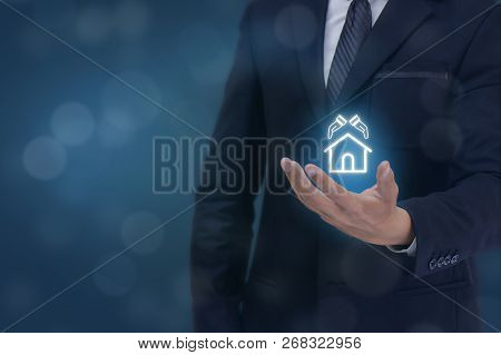 Insurance Concept, Business Man Hand Holding The Protection Home,construction Icon , Meaning Man, Co
