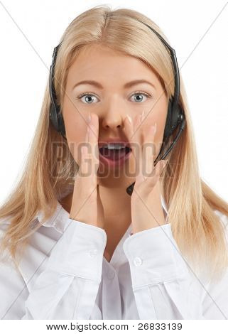 Close-up portrait of a pretty young female call center employee wearing a headset and screaming, against white background