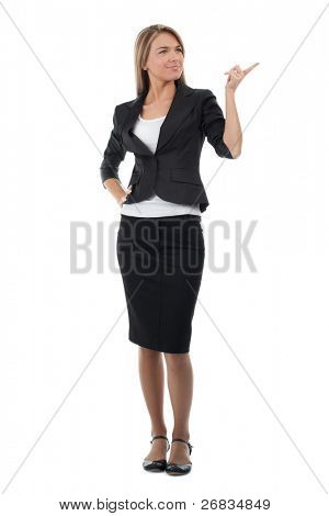 Full length portrait of attractive business woman pointing, isolated on white background