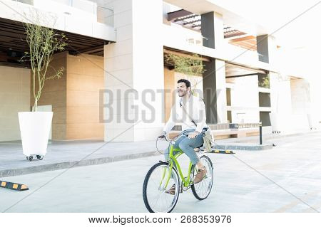 Full Length Of Professional Environmentalist Takes A Bike Ride By Office Building