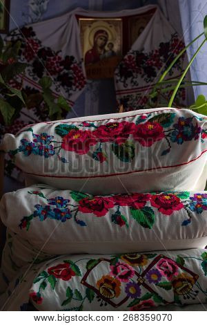 An Ancient Iron Bed With Embroidered Cushions.old Iron Bed With Pillows.embroidered Pillows On An Ol