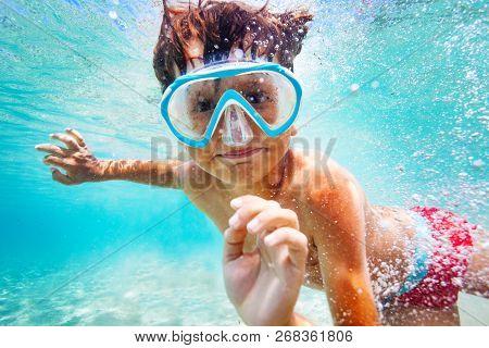 Happy Boy In Scuba Mask Swimming Underwater
