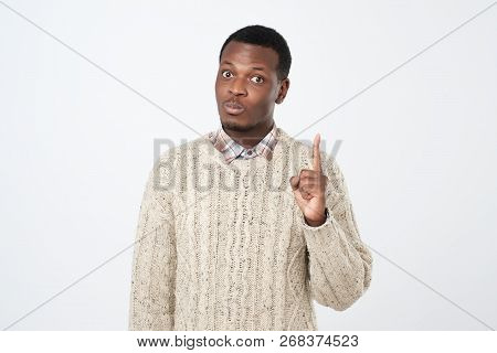 African Young Man Showing Index Fingers Up, Giving Advice