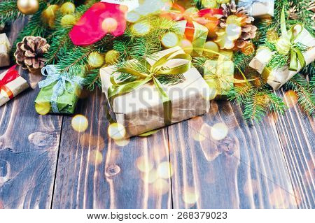 Christmas Decorations. Wooden Background And Table. Gifts And Baubles.
