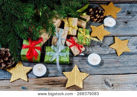 Christmas Decoration With Gifts And Present Boxes Under A Pine Tree.golden Harmony.