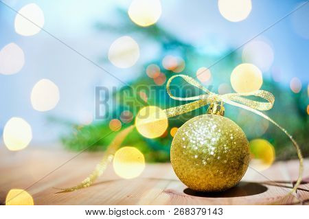 Christmas Golden Ball On Abstract Background Copyspace