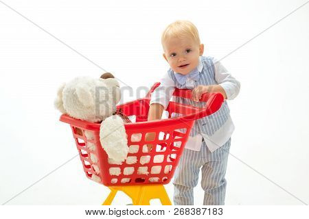 Little Boy Child In Toy Shop. Little Boy Go Shopping With Full Cart. Savings On Purchases. Happy Chi