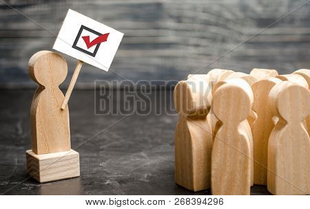 A Man With A Poster Agitates A Group Of People. Voters, The Political Process. Political Movement, F