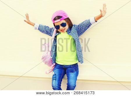 Fashion Little Girl Child In Baseball Cap Having Fun In City On White Background