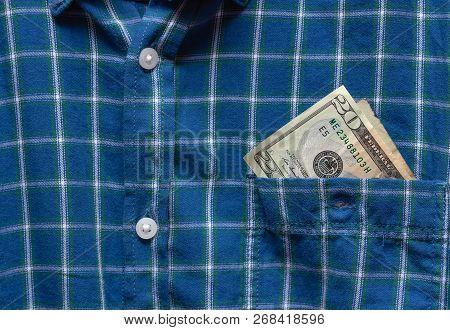 20 Dollars Stick Out Of Shirt Pocket. Busines Concept