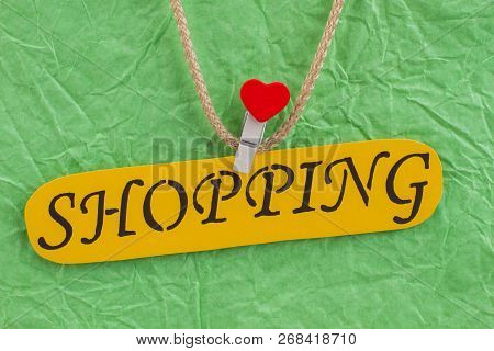 Close Up Yellow Card With Inscription Shopping. Macro Of Green Shopping Bag With Attached Inscriptio