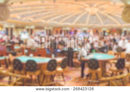 Defocused Background Of Gambling Casino Tables. Intentionally Blurred Post Production For Bokeh Effe