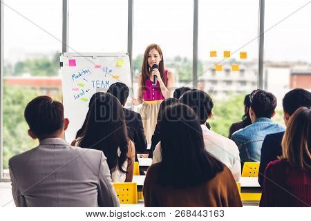 Businesswoman Standing In Front Of Group Of People In Consulting Meeting Conference Seminar At Hall