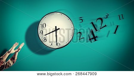 Hands Catching A Clock With Numbers Detached In The Air. Lack Of Time Concept . The Concept Of Time