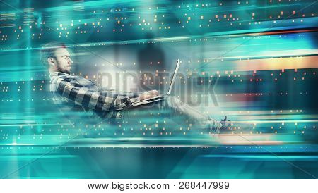 Man Working On Laptop In Futuristic Digital Backgroud. High Speed Browsing .