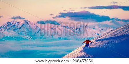 Sunset ski with amazing view of swiss famous mountains in beautiful winter  powder snow  The skituring, backcountry skiing in fresh powder snow.