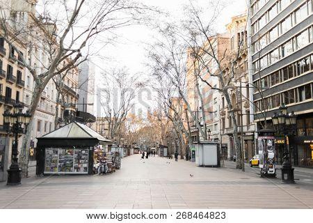 Barcelona, Spain - March 18, 2018: Morning on La Rambla Street in Barcelona, Spain.