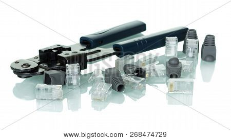 Crimping Tool For Twisted Pair Network Cable With Connectors And Caps Isolated On White Background