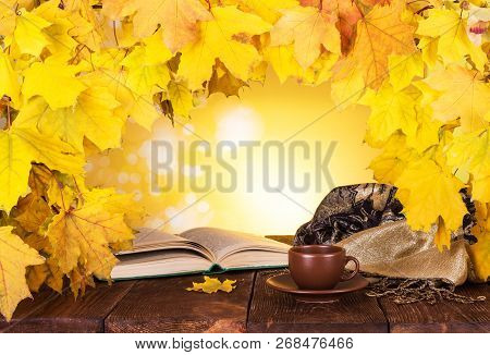 Autumn Composition. Maple Leaves, Hot Tea And An Open Book