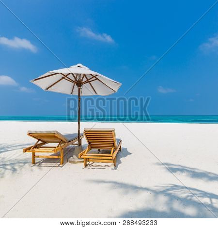 Beautiful Beach. Chairs On The Sandy Beach Near The Sea. Summer Holiday And Vacation Concept For Tou
