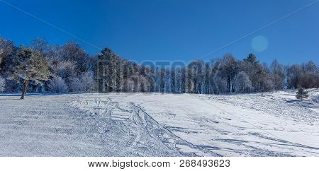 Panoramic Photo Winter Landscape With Snow Slope For Sledding, Tubing And Snowmobiling In The Early