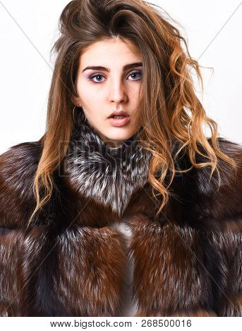 Hair Care Concept. Girl Fur Coat Posing With Hairstyle On White Background Close Up. Prevent Winter
