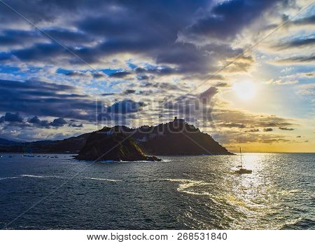 The Sun Sets Behind The Santa Clara Island And The Monte Igueldo Mount, Principal Elements Of The Co