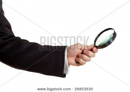 Hand holding a magnifying glass isolated on white.