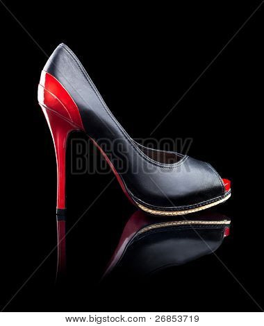 Black and red female high heels shoes on a black background - Side View